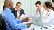 Stock Video Footage of Multi Ethnic Medical Team Meeting with Financial Advisor