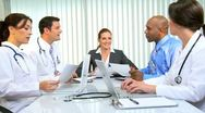 Multi Ethnic Medical Team Meeting with Financial Advisor  Stock Footage
