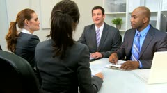 Ethnic and Caucasian Business Team Meeting  Stock Footage