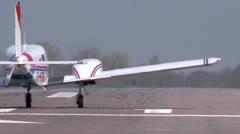 Tight shot of a twin engined light aircraft taking off from behind Stock Footage