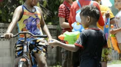 Young Boy Playing with a Water Pistol During Songkran Festival Stock Footage