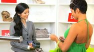 Stock Video Footage of Female Paying Goods Small Boutique
