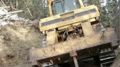 Heavy tracked bulldozer breaking up dirt on a gold mine in Alaska HD209 - stock footage