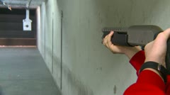 Firing a pump shotgun, indoor range, #3 Stock Footage