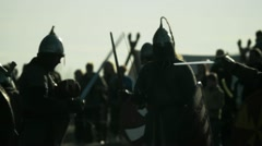 Stock Video Footage of Knightly Figure. Unarmed Combat. Armed Forces. Battlefield.