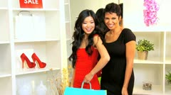 Multi Ethnic Girlfriends Smiling to Camera While Shopping  - stock footage