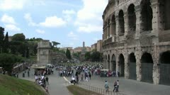 Tourists Walk Outside Colosseum in Rome Stock Footage