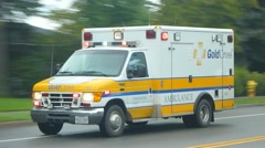 Emergency Ambulance Driving During Inline Marathon Stock Footage