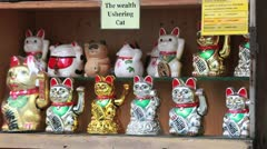 Wealth ushering cats Stock Footage