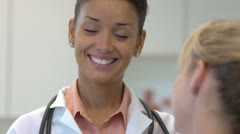Female doctor talking with patient Stock Footage