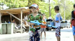 Young Boy with Water Pistol During Songkran Festival Stock Footage