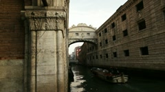 Boat passing under Bridge of Sighs in Venice Stock Footage