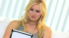 Blonde Female Tablet Online Auction  Stock Footage