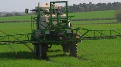 Crop spraying - fertilizer - backlit, from behind Stock Footage
