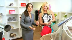 Fashion Outlet Assistant with Female Shopper  Stock Footage