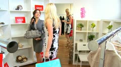 Boutique Manager Helping Fashion Conscious Client  - stock footage