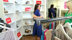 female Friends Shopping Chic Boutique  - stock footage