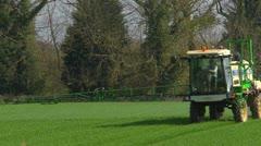 Crop spraying - fertilizer - backlit, mid shot, head on. Stock Footage