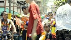 Boy With Water Pistol In Songkran Water Fight Stock Footage