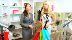 Caucasian Store Assistant with Female Shopper  Stock Footage