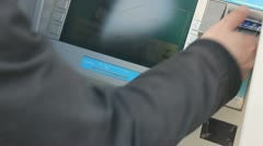 Customer using ATM machine Stock Footage