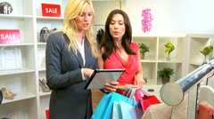 Customer Viewing Online Fashion Collection  Stock Footage