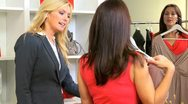 Stock Video Footage of Blonde Boutique Manager Helping Fashion Conscious Client