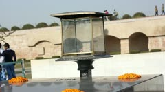 Eternal flame burning at Raj Ghat memorial, New Delhi, India Stock Footage