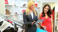 Boutique Client Viewing Online Collection  Stock Footage
