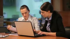 Two women working with computer - stock footage