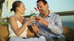 Couple having drinks and relaxing at an outdoor restaurant HD Stock Footage