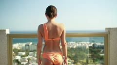 Sexy young woman standing on terrace with beautiful view HD Stock Footage