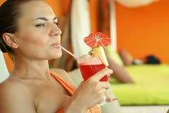 Young sexy woman drinking exotic cocktail in luxury bar  NTSC - stock footage