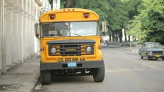 Yellow american school bus in the street Stock Footage