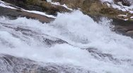 Slow motion waterfall. Water crashes over rock. Looping Stock Footage
