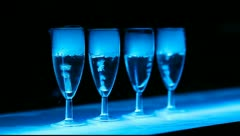 Angle view on colorfull boiling glasses in the bar Stock Footage