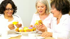 Multi Ethnic Retired Girlfriends Enjoying Tea Cupcakes  Stock Footage