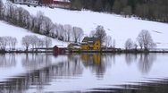 A Norwegian farm reflected in Hornindal Lake, looping Stock Footage