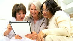 Mature Multi Ethnic Friends Wireless Tablet Apps  - stock footage