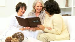 Senior Female Friends Laughing Photo Album  Stock Footage