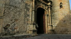 Spain Extremadura Caceres man in church door Stock Footage