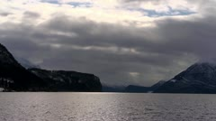 Sunbeams in Norway, lake, mountains and boat. Time lapse Stock Footage