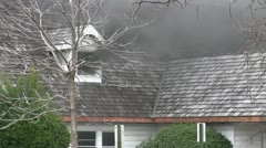 Amid the Force of Nature - House Fire Inside Sends Black Smoke Outside - stock footage