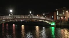 Dublin's HaPenny Bridge at night Stock Footage
