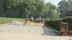 Work crew building a road in New Delhi, India Stock Footage