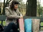 Happy woman checking her shopping bags in the park, steadicam shot NTSC Stock Footage