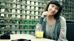 Happy woman drinking juice in outdoor bar, steadicam shot HD Stock Footage