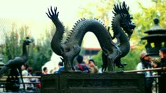 Dragon sculpture in Summer Palace with visitors blurred, Beijing, China Stock Footage