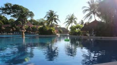 Big Swimming Pool with Palm Trees and Clear Sky - stock footage