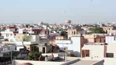 Children flying kites over the rooftops of Jaipur, India Stock Footage